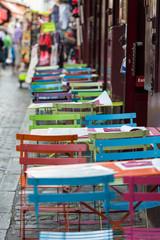 Paris - Very colorful Parisian outdoor cafe in Montmartre