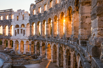 Aluminium Prints Ruins Architecture Details of the Roman Amphitheater Arena in Sunny Summer Evening. Famous Travel Destination in Pula, Croatia.