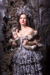 Christmas concept. Pretty woman in carnival dress.