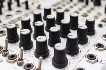 analog synthesizer , knobs macro on music equipment