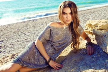 beautiful woman with dark hair, posing on summer beach