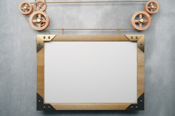 Blank picture frame in the style of steampunk hanging on concret
