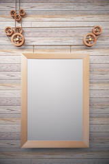 Blank picture frame in the style of steampunk hanging on wooden