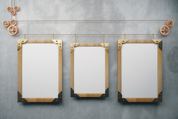 Three empty picture frame in the style of steampunk hanging on a