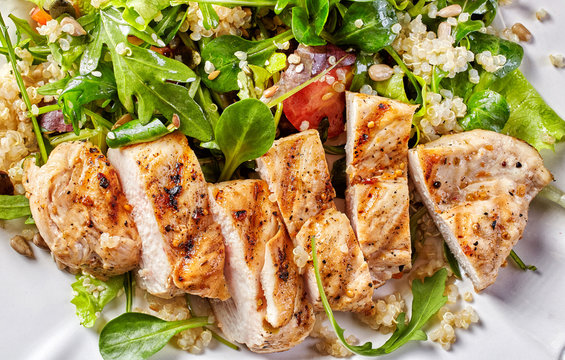 Quinoa and vegetable salad with grilled chicken