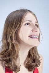 Caucasian Teenage Girl Showing Her Teeth Brackets