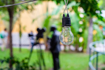 Light bulb on string wire with blurred background