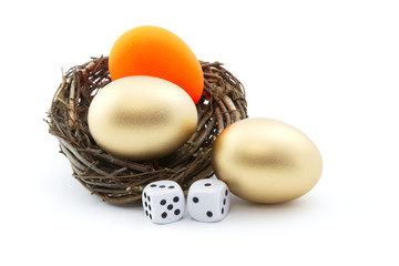 Dice and red nest egg reflect investment risk