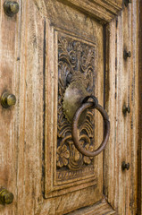 Fragment of wood carving on the door.
