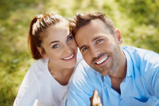 Closeup of happy couple looking at camera