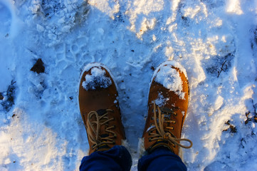 Brown boots in the snow