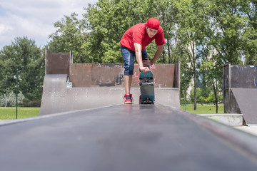 Skateboarder doing a jumping trick at skateboard park