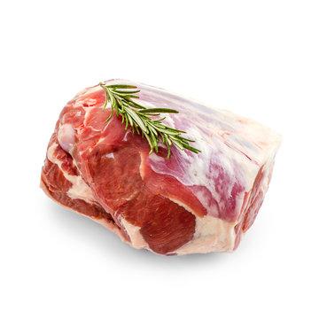 Raw lamb leg with rosemary twig