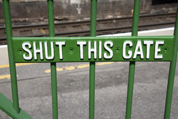 Green Shut This Gate Sign on Platform
