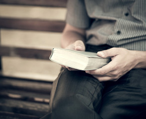the man with the bible on the bench