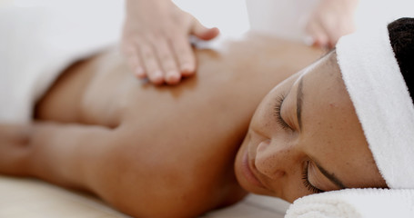 Masseur doing massage on woman body in the spa salon