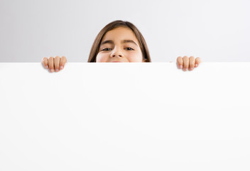 Girl holding a whiteboard