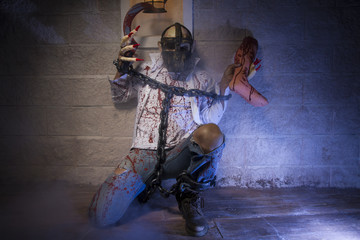dramatic, Man chained with blood and knife, has a severed leg bl