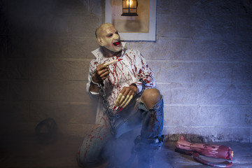 zombie, Man chained with blood and knife, has a severed leg bloo