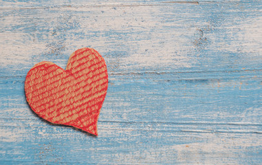 Crate paper Heart,Red heart,Blue wooden floor.