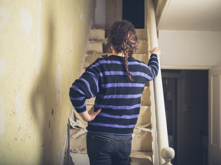 Young woman renovating a staircase