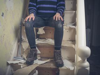 Young woman renovating staircase