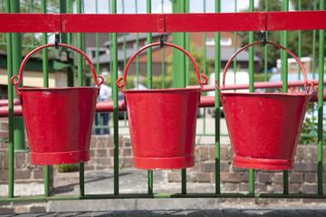 Three Red Buckets at Railway Station