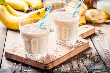 Fotobehang Milkshake Banana smoothie with oatmeal, peanut butter and milk