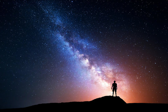 Milky Way. Night sky with stars and silhouette of a man
