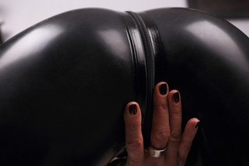 Perfect woman ass in latex suit