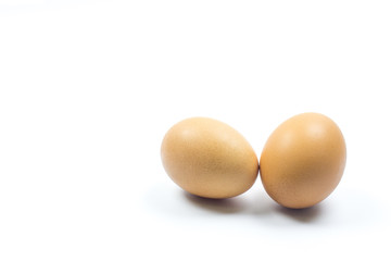 Two brown chicken egg isolated on white