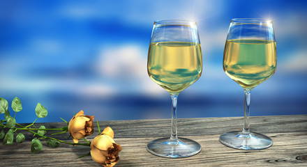 Two wine glasses filled with white wine with two yellow roses in daylight