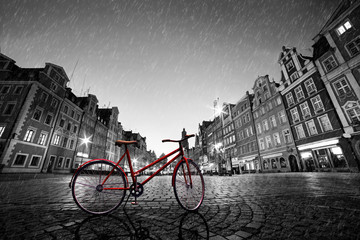 Fototapete - Vintage red bike on cobblestone historic old town in rain. Wroclaw, Poland.