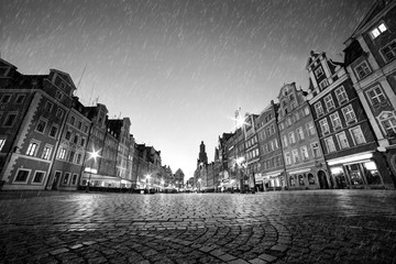 Fototapete - Cobblestone historic old town in rain at night. Wroclaw, Poland. Black and white