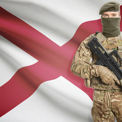 Soldier with machine gun and USA state flag on background - Alabama