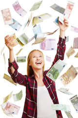 Young woman in rain of Euro money bills