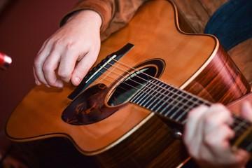 Acoustic Guitar Playing. closeup Men hands Playing Acoustic Guitar