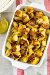 Roasted fried potatoes with garlic, rosemary
