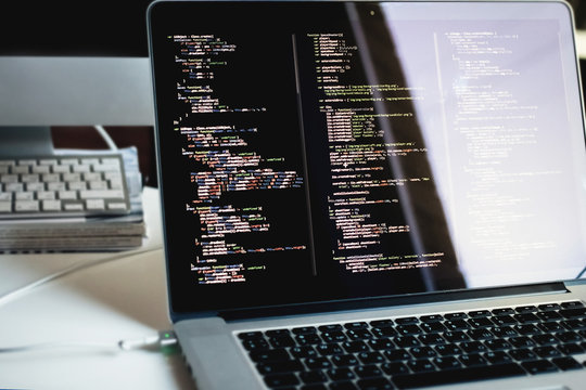 js code on laptop screen, web development