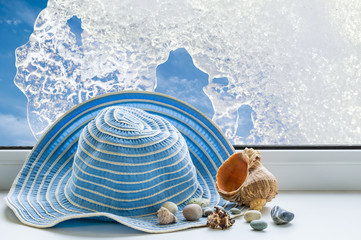Summer hat, seashells on a background of sky