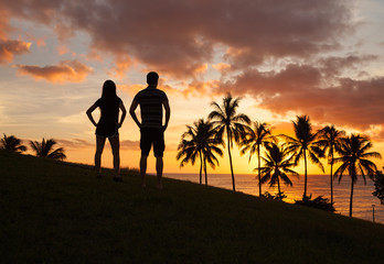 Romantic couple enjoying beautiful sunset in Hawaii