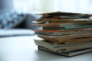 Pile of old books on white table