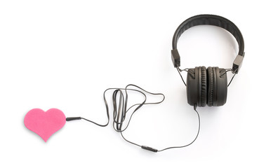 Concept with headphones and pink heart