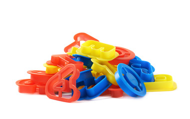 Pile of plastic letter forms isolated