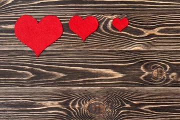 Handmade hearts against wood-grain wall