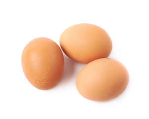 Three brown eggs composition isolated