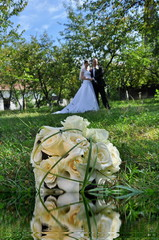 Wedding bouquet of  white rose reflected in water