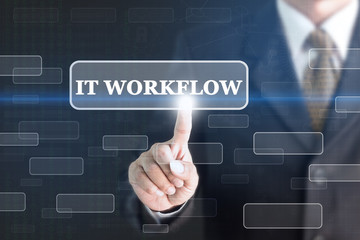 Businessman pressing IT WORKFLOW concept button. Can be used in advertising.