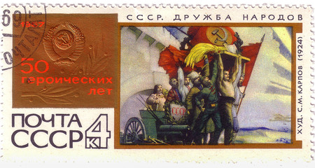 """USSR - CIRCA 1967: A stamp printed in the USSR, devoted 50 heroic years, picture """"Friendship of the people"""" S.M.Karpov circa 1967"""