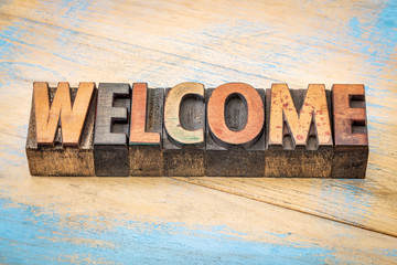 welcome sign in vintage wood type Wall mural
